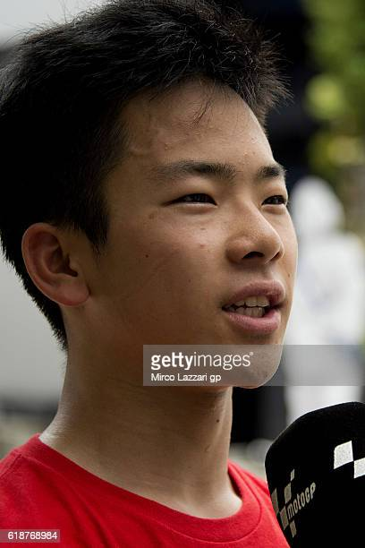 Ayumu Sasaki of Japan and Team Tasca Scuderia Moto2 speaks with journalists during the MotoGP Of Malaysia Free Practice at Sepang Circuit on October...