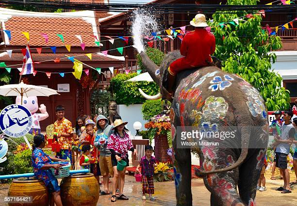 AyutthayaThailand13 April 2015 Elephant is playing water with Thai people during Songkran festival 2015