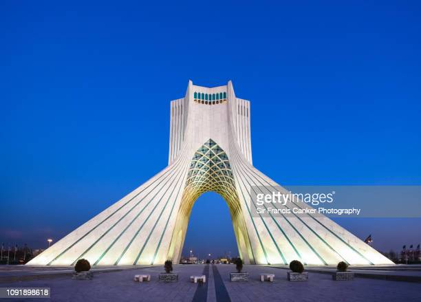 Azadi Tower illuminated at late dusk in Tehran, Iran