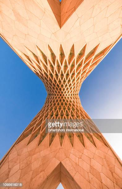 azadi tower under the last evening sunbeams in tehran, iran - tehran stock pictures, royalty-free photos & images