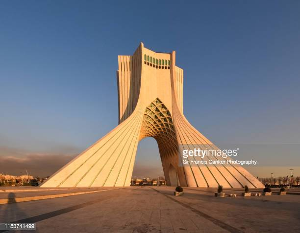 azadi tower under the last rays of sunlight in tehran, iran - シルクロード ストックフォトと画像