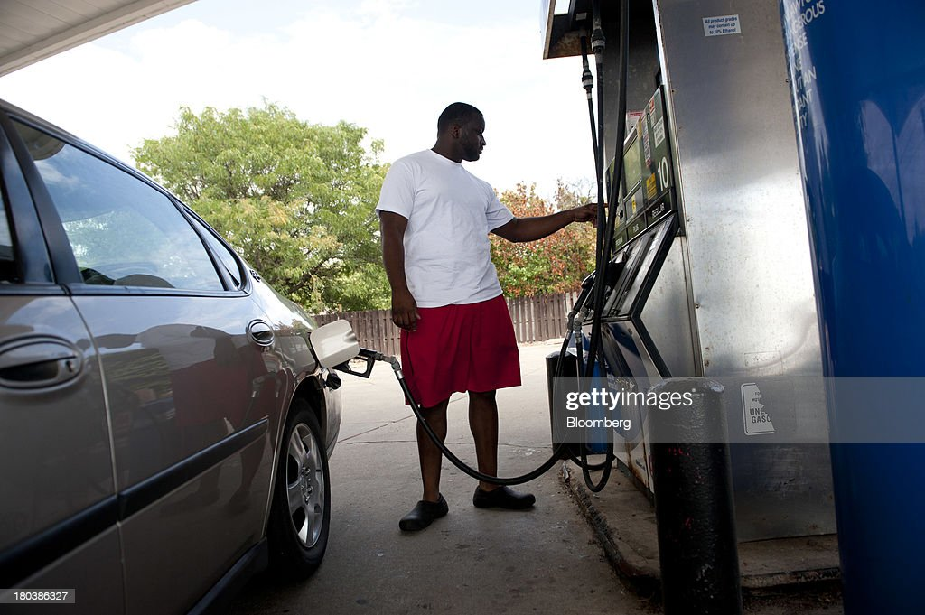 Azadia Boyd prepares to buy fuel at a gas station in Peoria, Illinois, U.S., on Wednesday, Sept. 11, 2013. Gasoline climbed in New York trading as crude advanced before talks between the U.S. and Russia over disposing of Syrias chemical weapons and as U.S. jobless claims dropped. Photographer: Daniel Acker/Bloomberg via Getty Images
