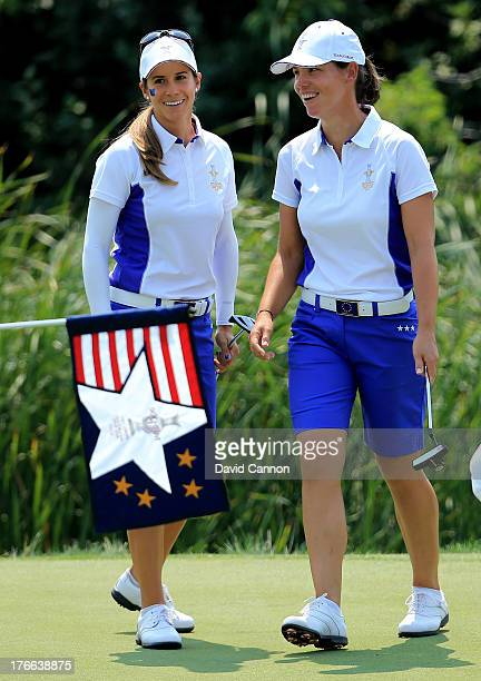 Azahara Munoz of Spain and Karine Icher of France and the European Team are all smiles after winning their match on the 17th green by 2 and 1 during...
