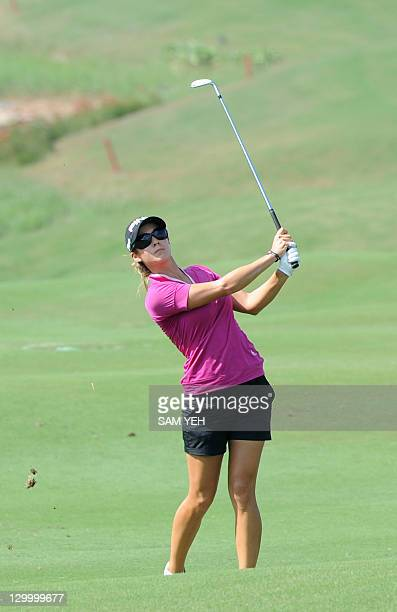 Azahara Munoz of Spain hits a shut on the sixth hole during the forth round of the Sunrise LPGA Taiwan Championship golf tournament in Yangmei...