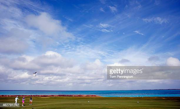 Azahara Munoz of Spain Inbee Park of South Korea and Paula Creamer play the eighth hole during round one of the Pure Silk Bahamas LPGA Classic at the...