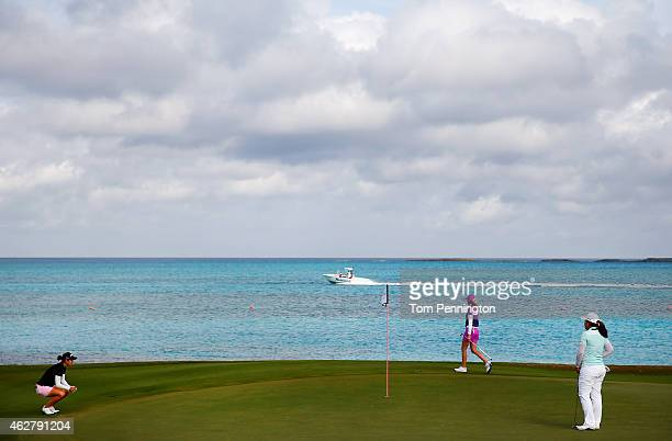 Azahara Munoz of Spain Paula Creamer and Inbee Park of South Korea play the eighth hole during round one of the Pure Silk Bahamas LPGA Classic at the...