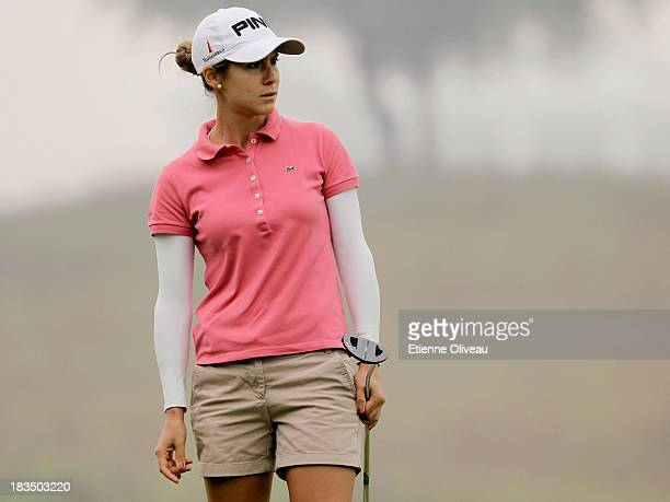 Azahara Munoz of Spain watches prepares a putt during the final round of the Reignwood LPGA Classic at Pine Valley Golf Club on October 6 2013 in...
