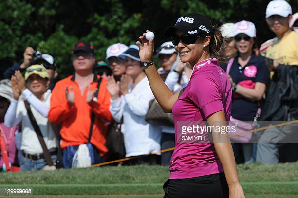 Azahara Munoz of Spain waves after scoring an eagle on the sixth hole during the forth round of the Sunrise LPGA Taiwan Championship golf tournament...