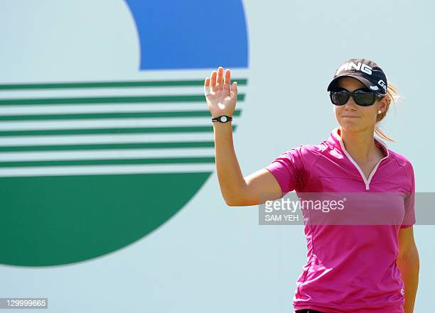 Azahara Munoz of Spain waves before teeing off on the first hole during the forth round of the Sunrise LPGA Taiwan Championship golf tournament in...