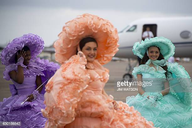 Azalea Trail Maids smile as US Presidentelect Donald Trump arrives in Mobile Alabama for a 'Thank You Tour 2016' rally on December 17 2016 / AFP /...