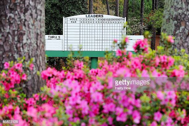 Azaleas bloom in front of a leaderboard during a practice round prior to the 2009 Masters Tournament at Augusta National Golf Club on April 6, 2009...
