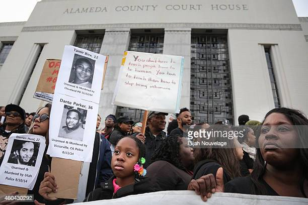 Azaniyn Newton and Nina Moore both of Oakland stand on the setps of the Alameda County Court House during a 'Millions March' demonstration protesting...