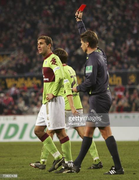 Azar Karadas of Kaiserslautern is booked by red card from referee Thorsten Kinhoefer during the Second Bundesliga match between 1.FC Cologne and 1.FC...