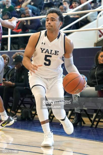 Azar Swain of the Yale Bulldogs dribbles the ball during a college basketball game against the against the Howard Bison at Burr Gymnasium on January...