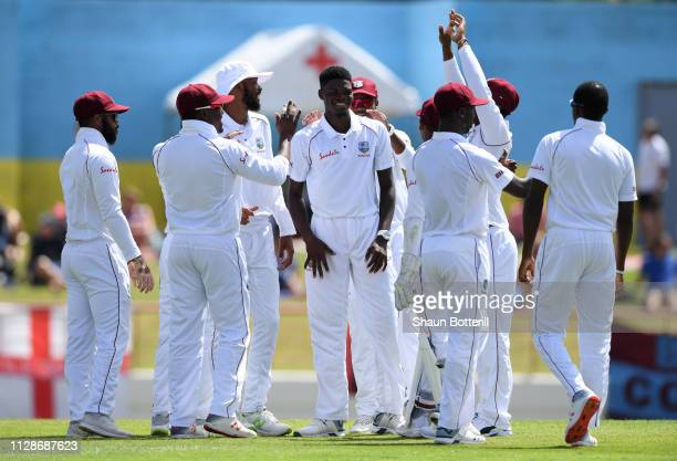 Azarri Joseph of West Indies is congratulated by team-mates after taking the wicket of Moeen Ali of England during Day Two of the Third Test match...