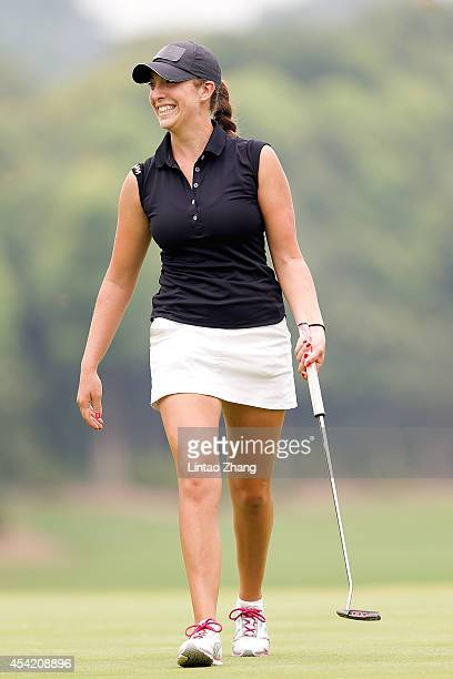 Azelia Meichtry of Switzerland celebrates after chipping in for an eagle during the Mixed Team on day ten of the Nanjing 2014 Summer Youth Olympic...