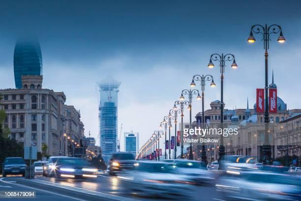 azerbaijan, baku, heydar aliyev prospect, traffic at dusk - heydar aliyev stock pictures, royalty-free photos & images