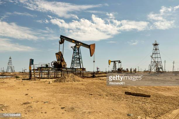 azerbaijan, baku, oil fields - oil field stock pictures, royalty-free photos & images