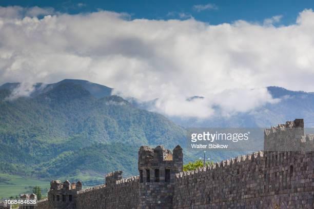 azerbaijan, ismayili, old city walls and caucasus mountains - azerbaijan stock pictures, royalty-free photos & images