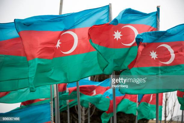Azerbaijan national flags fly in Baku Azerbaijan on Sunday March 18 2018 Two years after descending into junk Azerbaijan's shortest path to winning...