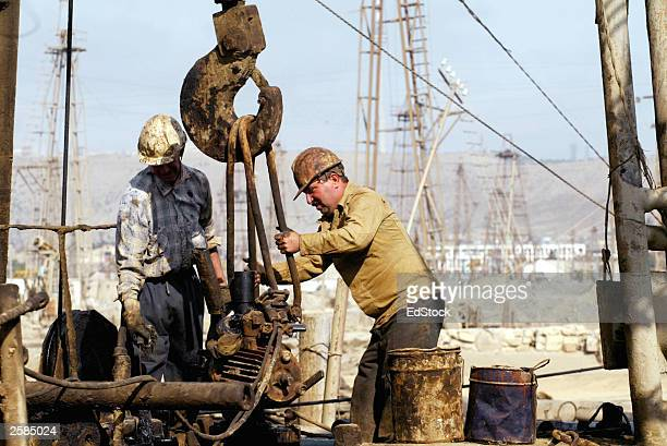 azerbaijan oil industry - oil worker stock pictures, royalty-free photos & images