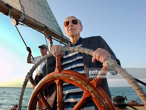 Azerbaijan President Geidar Aliev takes the helm of the Schooner America 05 April 2001 on a planned cruise around Key West Harbor during peace talks...