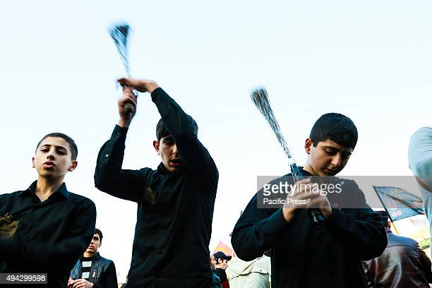 Azerbaijan Shiite Muslim devotees beat themselves with chains and blades as part of a selfflagellation ritual during Ashura commemorations in Baku's...