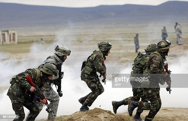Azerbaijani and US soldiers participate in a joint NATO military exercise outside Baku on April 24, 2009. Soldiers from Azerbaijan serve alongside...