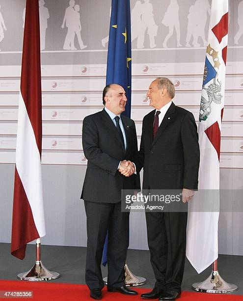 Azerbaijani Foreign Minister Elmar Mammadyarov is welcomed by Latvian President Andris Berzins as he arrives at the House of the Blackhead for a...
