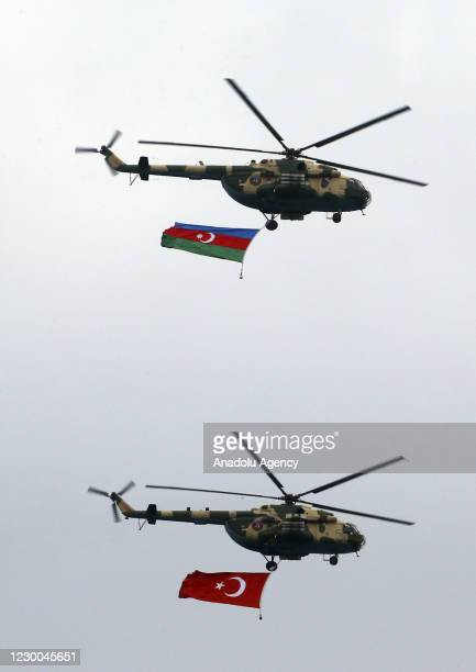 Azerbaijani military helicopters perform during the Victory Parade held to celebrate Azerbaijani army's victory in Nagorno-Karabakh at Azadliq Square...