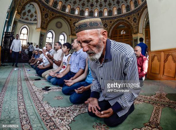Azerbaijani muslims pray on the first day of the Eid alAdha at the mosque in Baku on September 1 2017 Muslims across the world are celebrating the...