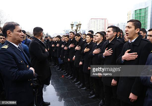 Azerbaijani people sing their National anthem during the commemoration of Khojaly Massacre in Baku Azerbaijan on February 26 2016 Khojaly Massacre in...