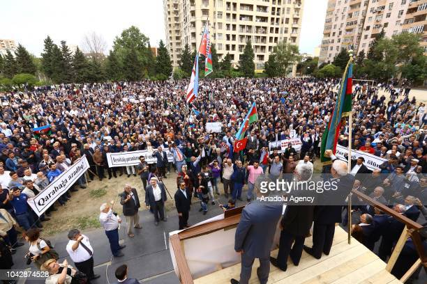 Azerbaijani people stage a protest against Armenia's occupation of Azerbaijan's territory NagornoKarabakh at the Mehsul stadium in Baku Azerbaijan on...
