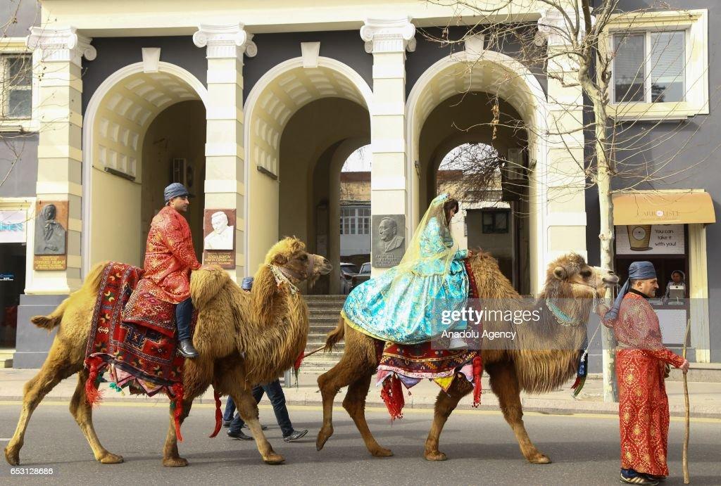 Azerbaijani people wearing traditional costumes take part in the Newroz celebrations in Baku, Azerbaijan on March 14, 2017.