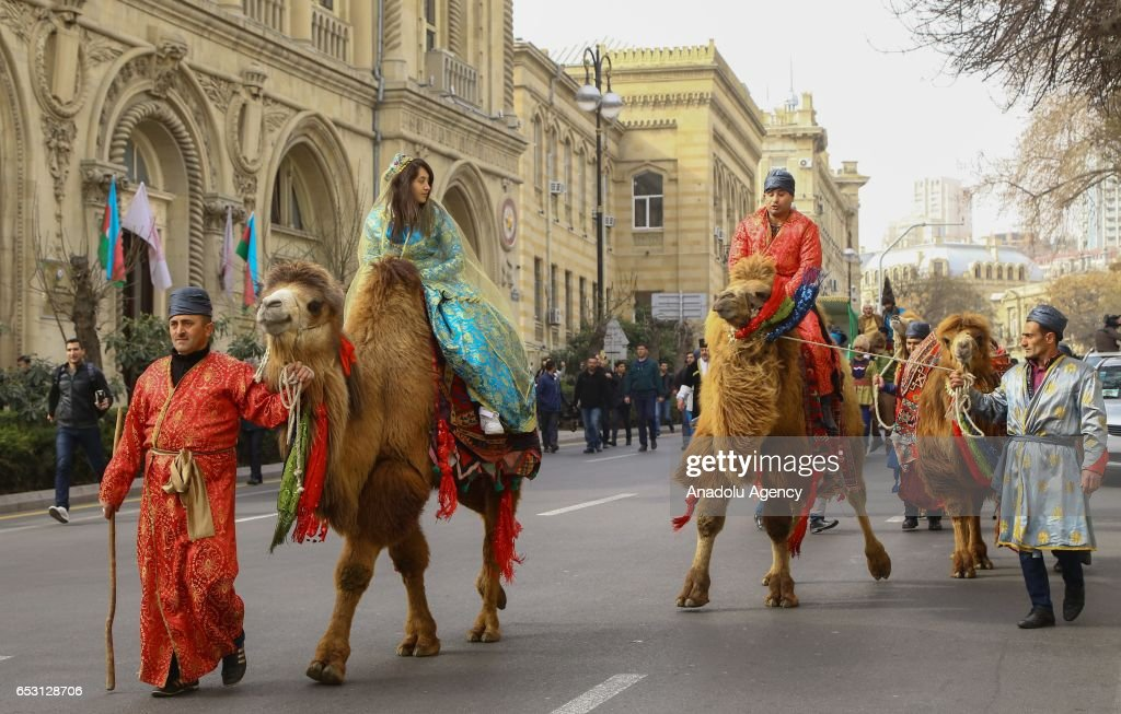 Azerbaijani people wearing traditional costumes take part in the Newroz celebrations in Baku, Azerbaijan on March 14, 2017.