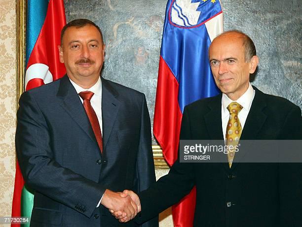 Azerbaijani President Ilham Aliev shakes hands with his Slovenian counterpart Janez Drnovsek, in Brdo Pri Kranju, some 40 kilometers north of the...