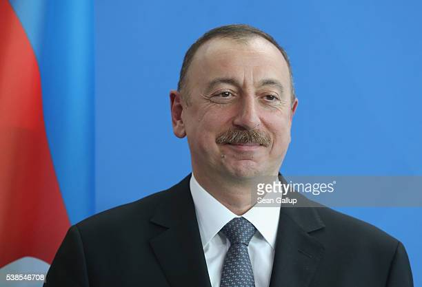 Azerbaijani President Ilham Aliyev and German Chancellor Angela Merkel depart after speaking to the media following talks at the Chancellery on June...