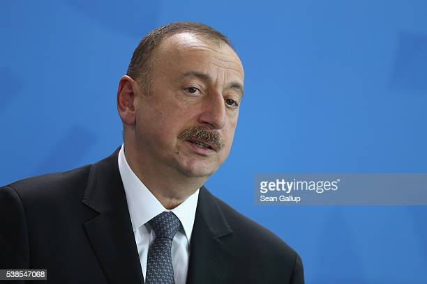 Azerbaijani President Ilham Aliyev and German Chancellor Angela Merkel speak to the media following talks at the Chancellery on June 7 2016 in Berlin...