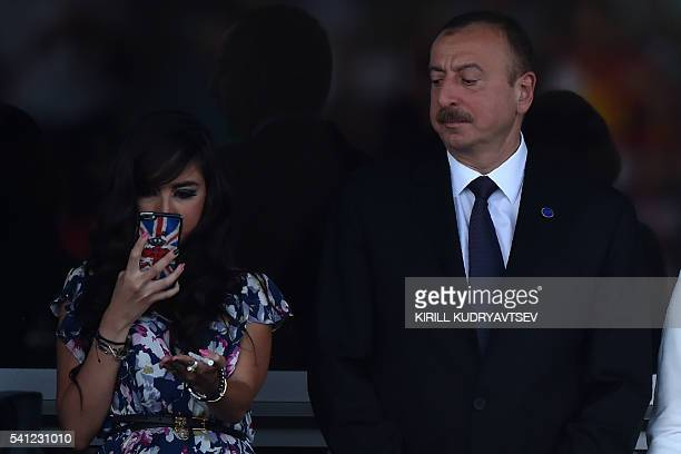 Azerbaijani President Ilham Aliyev and his daughter Leyla are seen on the stands at the Baku City Circuit on June 19 2016 in Baku during the European...