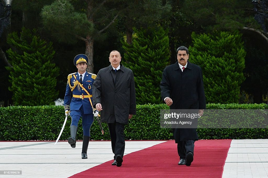 Azerbaijani President Ilham Aliyev (Left 2) and Venezuelan President Nicolas Maduro (right) walk past honor guard during official welcome ceremony prior to their meeting in Baku, Azerbaijan on October 22, 2016.