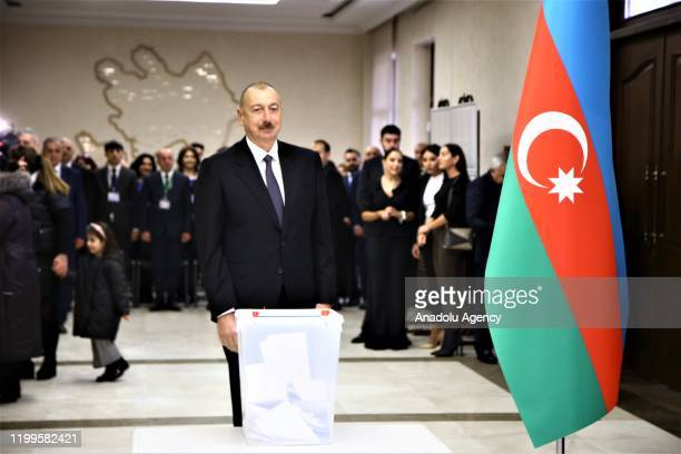 Azerbaijani President Ilham Aliyev casts his vote at a polling station during Azerbaijani snap parliamentary elections in Baku Azerbaijan on February...