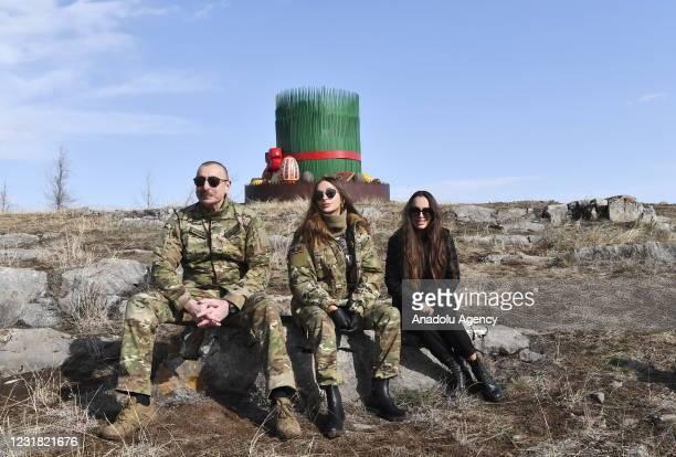 Azerbaijani President Ilham Aliyev , his wife Mehriban Aliyeva and his daughter Leyla Aliyeva pose after Ilham Aliyev ignited the Newroz fire in...