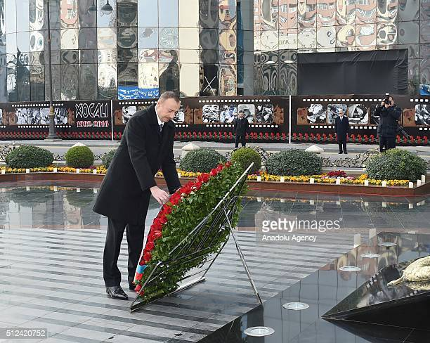 Azerbaijani President Ilham Aliyev lays wreath in front of Khojaly monument during the commemoration of Khojaly Massacre in Baku Azerbaijan on...
