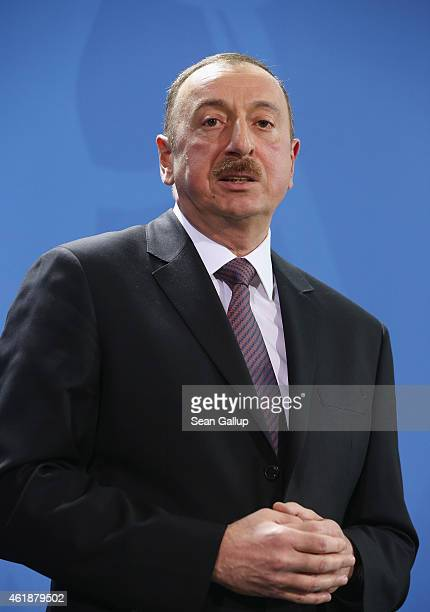 Azerbaijani President Ilham Aliyev sepaks to the media with German Chancellor Angela Merkel following talks at the Chancellery on January 21 2015 in...