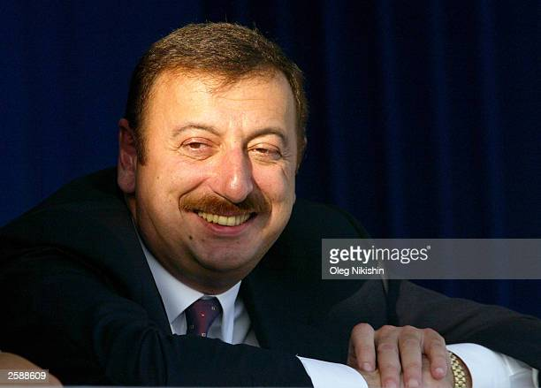 Azerbaijani Prime Minister Ilham Aliev attends a political rally ahead of the October 15 presidential elections October 13 2003 in Baku Azerbaijan...