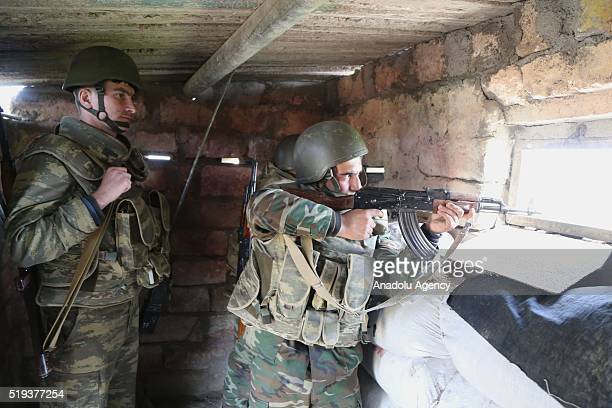 Azerbaijani soldiers are seen at their position in the Tartar region of Azerbaijan on April 6, 2016. Although Azerbaijan and Armenia agreed to cease...