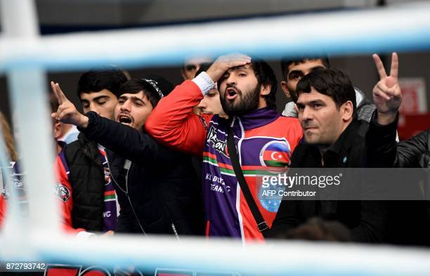 Azerbaijani teammates react in the 'BOK' sports hall in Budapest on November 9 2017 during the oneweek long ' World Association of Kickboxing...