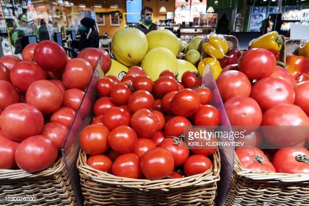Azerbaijani tomatoes are displayed for sale at a supermarket in Moscow on December 9, 2020. - Russia has announced a ban on imports of tomatoes from...