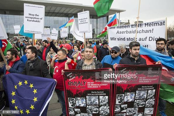 Azerbaijanis And Turks Living In Berlin Hold Azerbaijan Flags And News Photo Getty Images