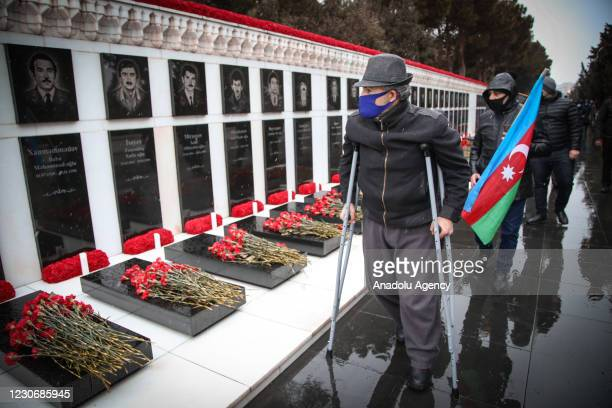 Azerbaijanis attend a commemoration ceremony within Azerbaijans 31st year of Black January, a violent crackdown during the dissolution of Soviet...